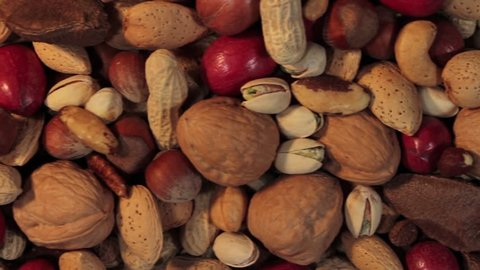 Nuts background with a mixed assortment of seeds and pecan with walnut brazil nut peanut,hazelnut pistachio almond and cashew as a healthy food symbol and nutritious protein and lifestyle icon.