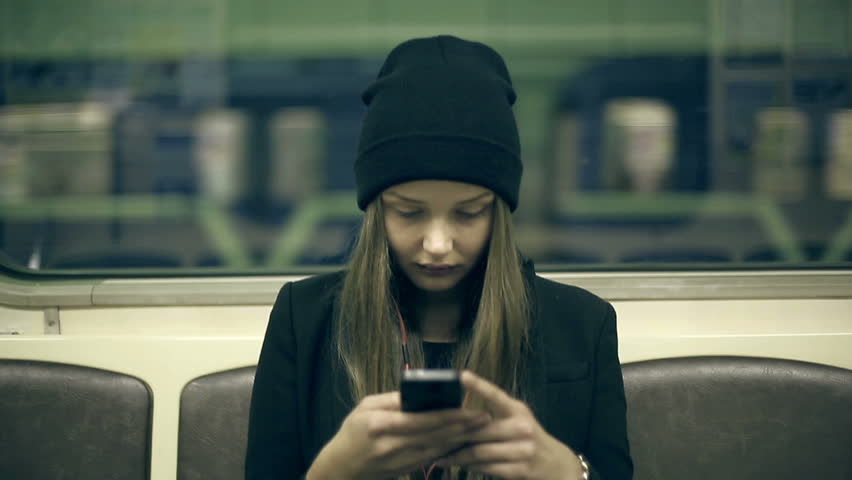 Teen girl rides the subway at night and used smartphone | Shutterstock HD Video #7774093