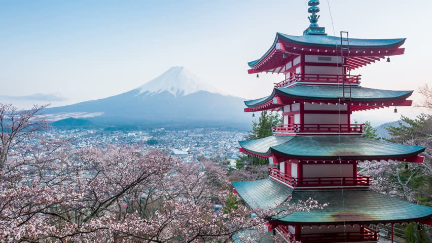timelapse view of Red Pagoda with Mt Fuji on the background