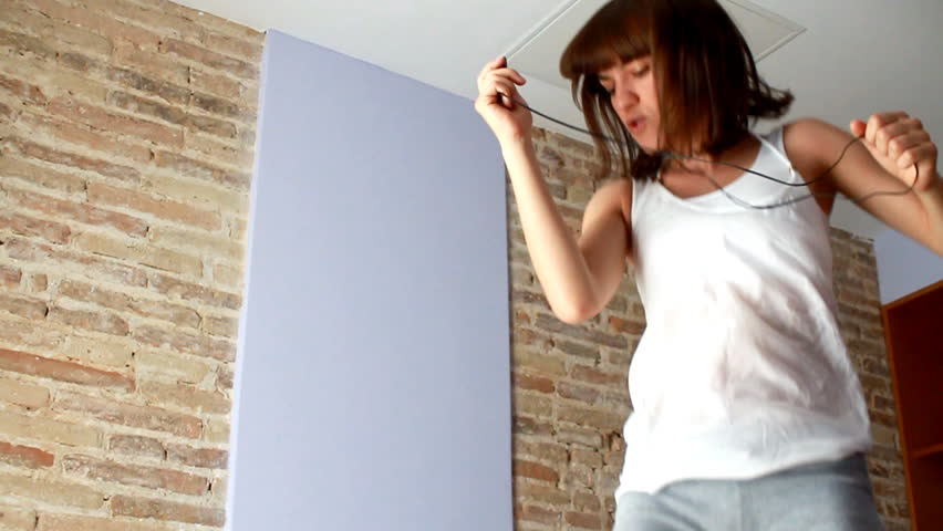 Woman jumping on bed, slow motion