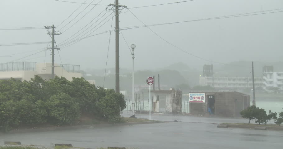 OKINAWA, JAPAN - OCTOBER 2014: Intense Hurricane Wind Rain Hits City. Strong winds and torrential rain lash a town as a powerful hurricane hits. Originally shot in 4K on Sony PXW Z100