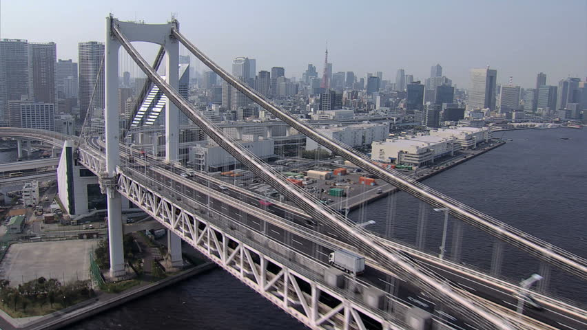 Aerial Rainbow Suspension Bridge Metropolis Odaiba travel Tokyo Bay Shuto Expressway vehicle Japan | Shutterstock HD Video #7796257