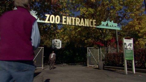 Visitors entering and exiting the main entrance at the Bronx Zoo,
