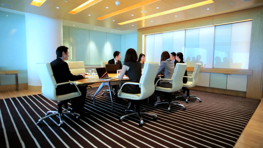 Ethnic Asian Chinese smart businessmen businesswomen corporate management conference meeting wireless laptop device planning | Shutterstock HD Video #7852057