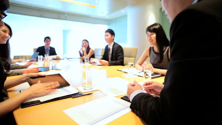 Boardroom conference meeting teamwork ethnic executive management planning business businessman businesswomen wireless laptop computer | Shutterstock HD Video #7852177
