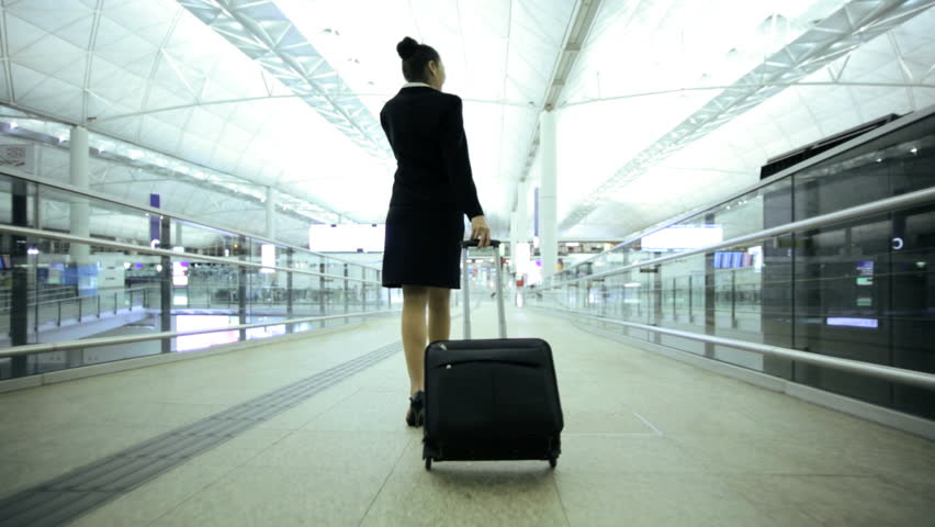 American Caucasian European woman airport passenger travel business meeting information departures luggage executive traveller airline | Shutterstock HD Video #7854382