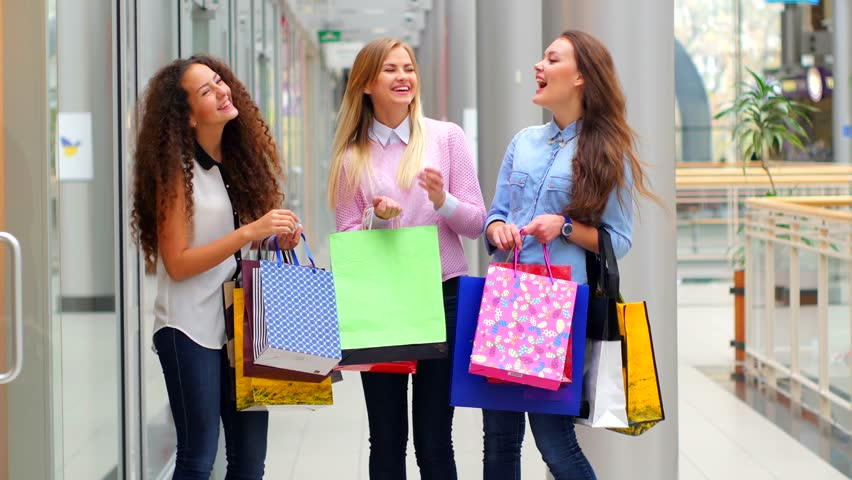 Three Beautiful Girls With Shopping Bags Watch Purchase On ...