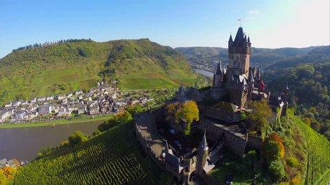 Beautiful castle vine hills river, German Cochem village aerial