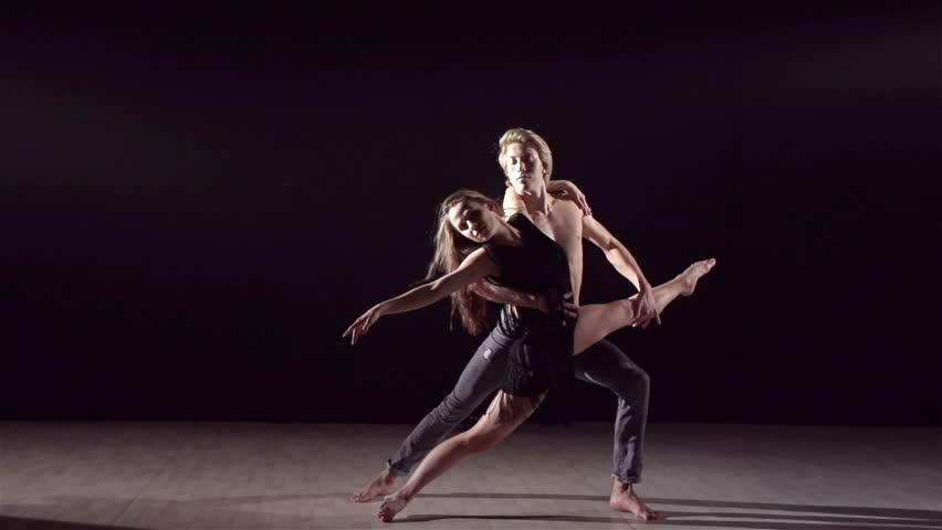 Dance partners demonstrating sensual dance pattern in slow motion