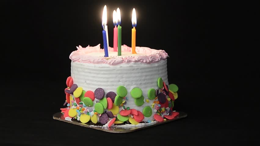 Candles Burning On Top Of A Birthday Cake Happy Are And Blown Out