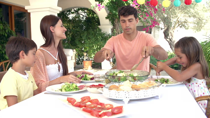 Hispanic family enjoying meal on outdoor terrace. Shot on Sony FS700 at frame rate of 25fps | Shutterstock HD Video #7918534