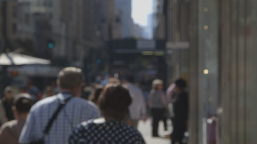An anonymous crowd walking down a crowded sidewalk in New York City, NY | Shutterstock HD Video #7920052