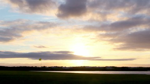 Algarve golf course sunset scenery at Ria Formosa conservation marsh landscape, famous golf and nature destination, Portugal. (Timelapse)