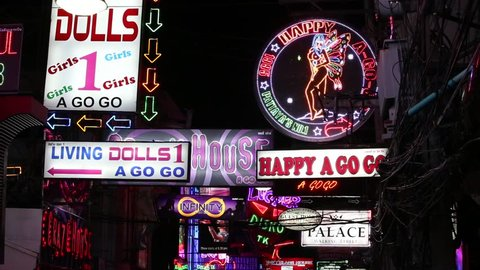 PATTAYA, THAILAND - NOVEMBER 15, 2014: Neon Signs nightlife clubs in Walking Street.  Walking Street is red-light district with many restaurants, go-go bars and brothels