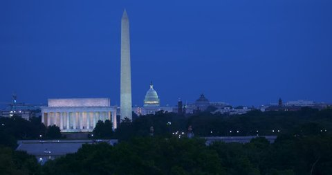 Washington DC skyline at dusk from near the Netherlands Carillon with blue sky and traffic