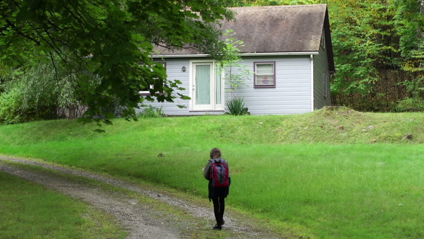 A tween girl walks home alone from school to a secluded cottage in the woods - property released | Shutterstock HD Video #7972567