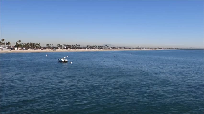 Small boat in ocean with beach in background | Shutterstock HD Video #7987027