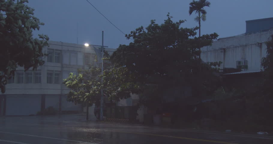 CHENGGONG, TAIWAN - AUGUST 2014: Strong Hurricane Winds Hit City At Night. Strong winds and torrential rain lash a city at night as a powerful hurricane hits. Shot on Sony Z100 4096x2160 30p - Matmo