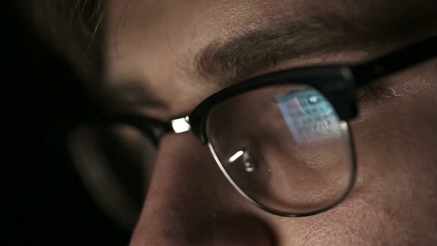 Portrait of a young man with glasses who works at night.  Close up | Shutterstock HD Video #8009119