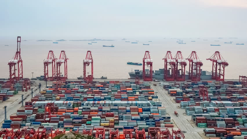 time lapse of busy container terminal in shanghai at dusk
