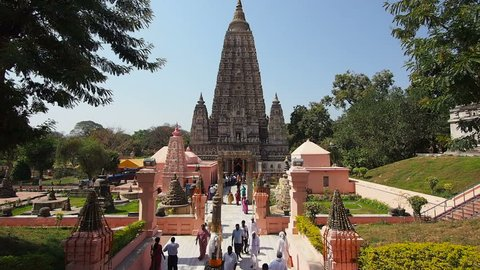 BODHGAYA, INDIA - FEBRUARY 27: People visiting the Mahabodhi Temple in Bodhgaya, India. The temple marks the location where Gautama Buddha is said to have attained enlightenment some 2500 years ago.