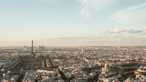 PARIS - NOVEMBER 20: Day-to-night timelapse overview of Paris city seen from above aerial point of view. day-time to night-time. 20 November 2014, Paris, France
