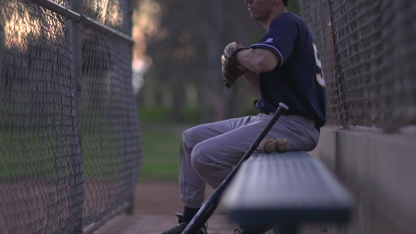 A baseball player resting on the bench. - Slow Motion - Model Released - 1920x1080 - HD - filmed at 59.94 fps | Shutterstock HD Video #8028457
