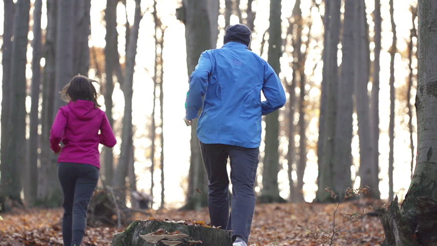 Couple jogging in autumn forest, super slow motion, shot at 240fps