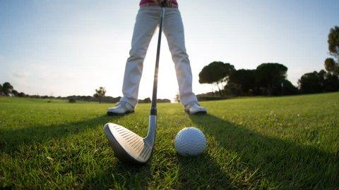 beautiful senior female golf player on a golf course