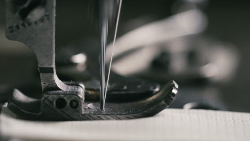 Super slow motion of vintage sewing machine stitching on white fabric (macro close up) | Shutterstock HD Video #8036257