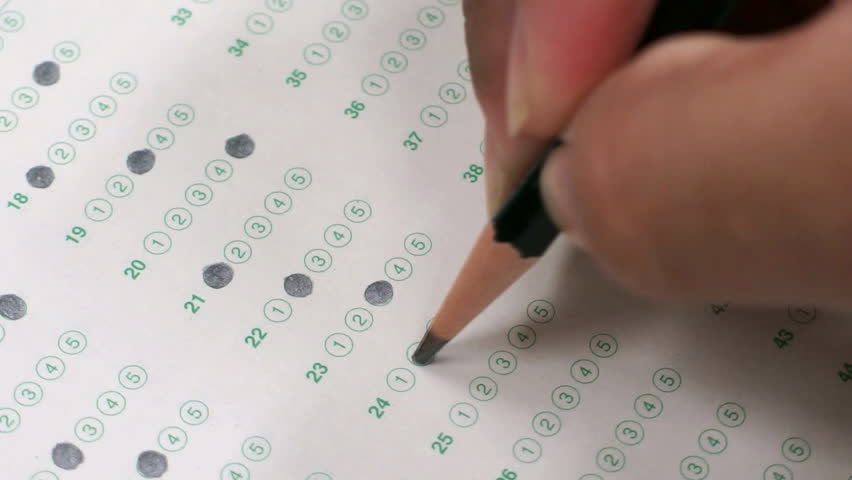 Filling in answer sheet for test | Shutterstock HD Video #8076472