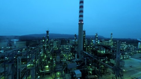 oil and gas refinery at twilight sky. aerial view fly over. industrial background