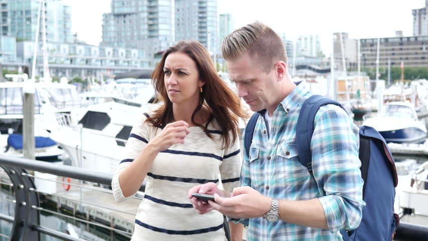 Couple taking a photo near water front | Shutterstock HD Video #8160307