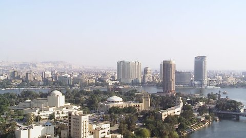 Tilt down from sky to general view of Cairo and Nile. Cairo is the capital of Egypt and the largest city in the Middle-East and second-largest in Africa after Lagos.
