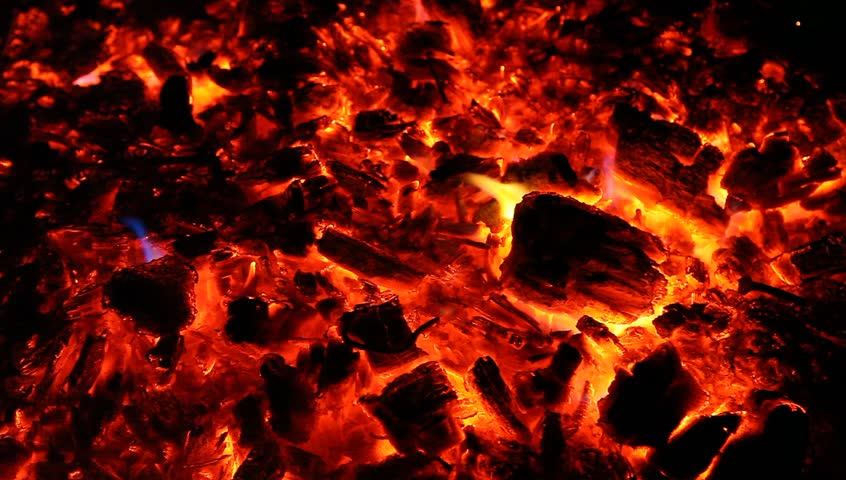 Embers and ashes of mighty big fireplace ablaze