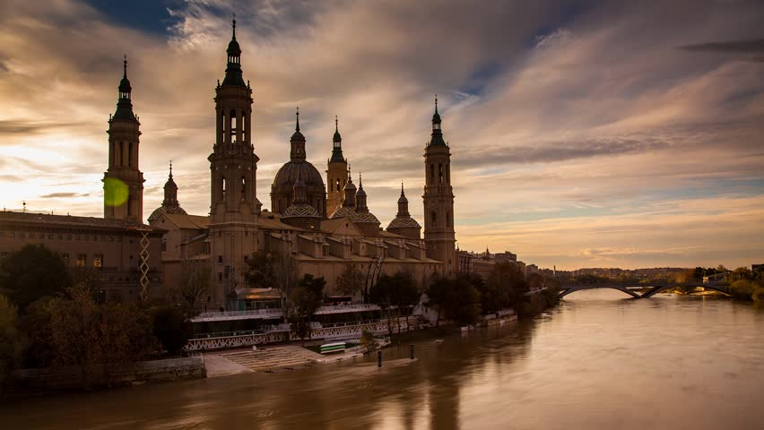 Basilica del Pilar, Cathedral of Our Lady of the Pilar next to river Ebro, timelapse transition from day to night.