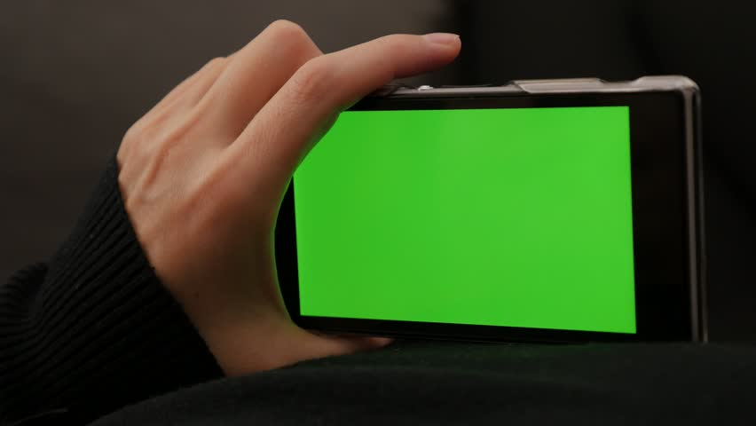 Content scrolling on mobile phone green screen display 4K 2160p UHD video - Woman holding smart phone with green screen display 4K 3840X2160 UHD footage   Shutterstock HD Video #8218636