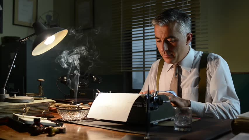 Vintage journalist working late at night at office desk with typewriter and smoking a cigarette.
