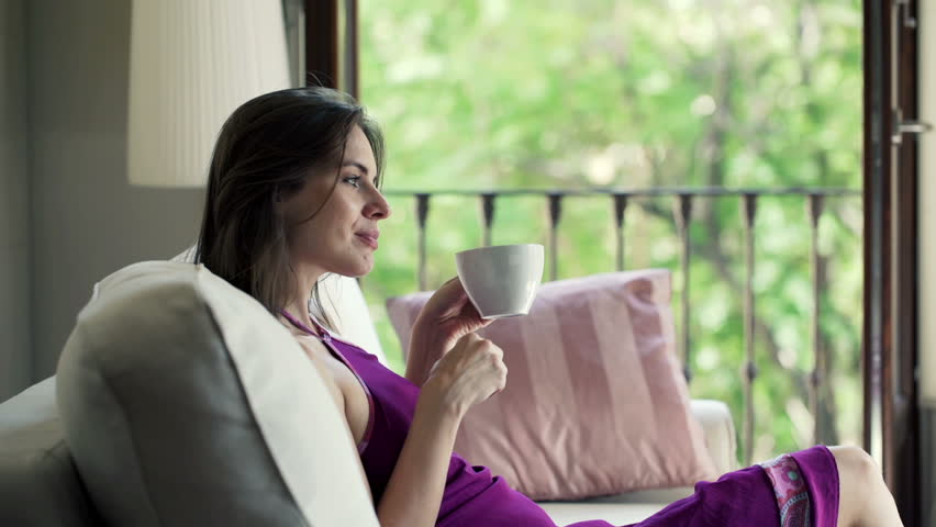 Woman Sitting On Couch Drinking Coffee Stock Footage Video ...