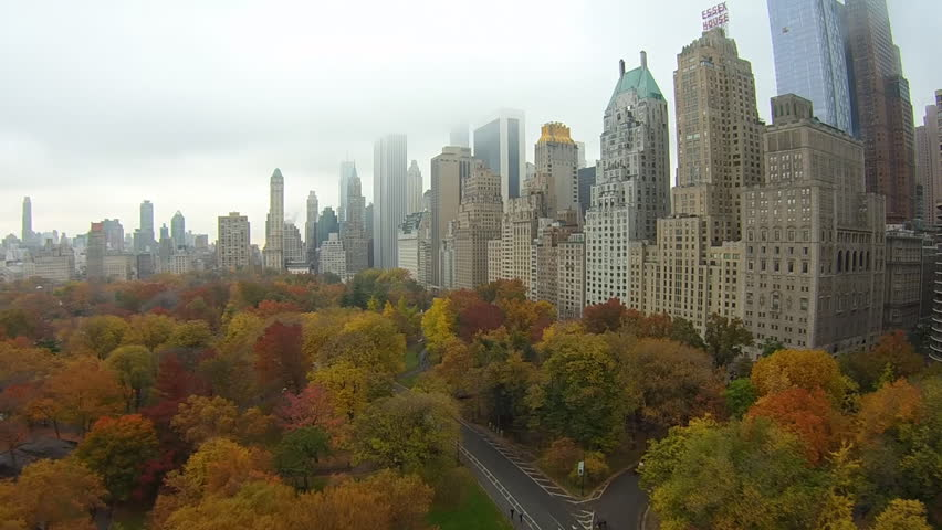 Float over colorful trees. New York, Central Park Aerial view mid Fall colors.Float over colorful trees.
