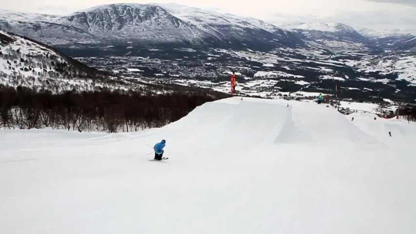 LILLEHAMMER, NORWAY - APRIL 19: A skier doing a jumping trick on skis in the winter at a ski resort. | Shutterstock HD Video #8251237
