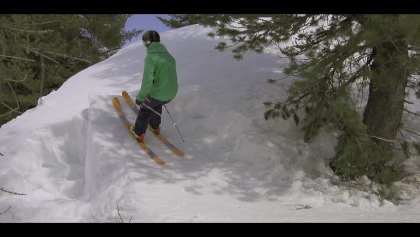 Two skiers jump one after the other before landing successfully on snow, slow motion   Shutterstock HD Video #8253397