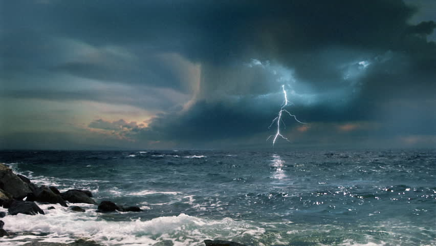 Cinematic storm clouds with lightning strikes reflecting in ocean. | Shutterstock HD Video #8264374