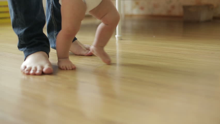 Baby girl ( 1 year old ) walking his first steps, dolly shot | Shutterstock HD Video #8268961