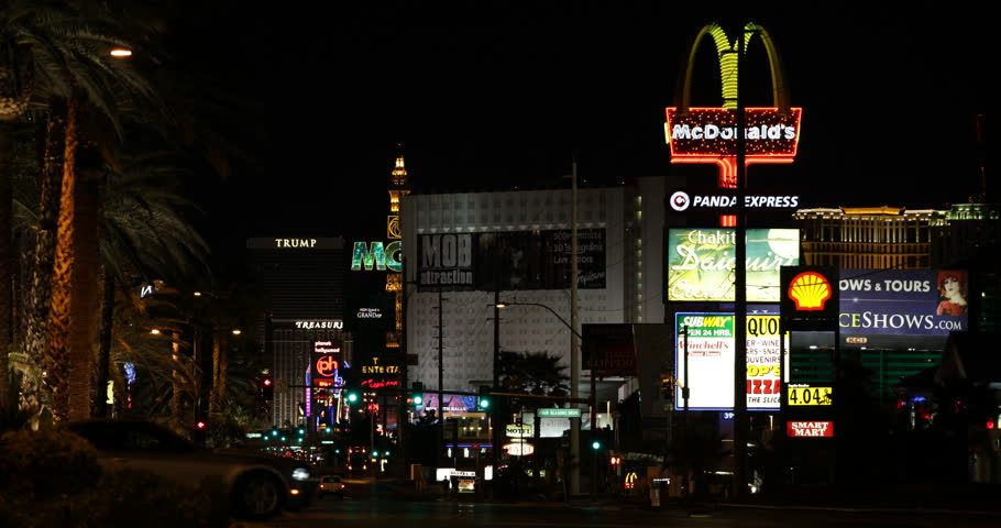 LAS VEGAS, USA - APRIL 28, 2013 Illuminated Night Las Vegas Strip Car Traffic Busy Street Neon Sign Lights Sight ( Ultra High Definition, UltraHD, Ultra HD, UHD, 4K, 2160P, 4096x2160 )   Shutterstock HD Video #8284447