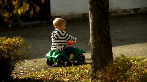 HD1080 Young blonde boy rides bobby car. Part 4.