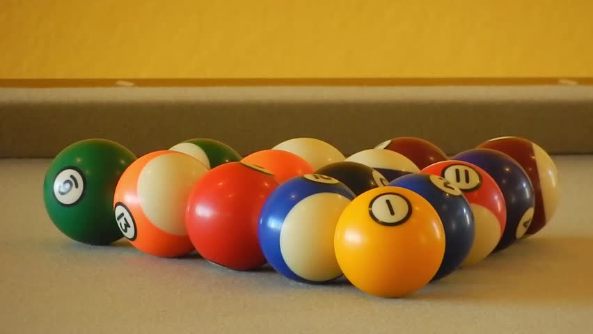 Cue Ball Strikes Pool Balls On Pool Table Side View CU. CU: A Cue ...