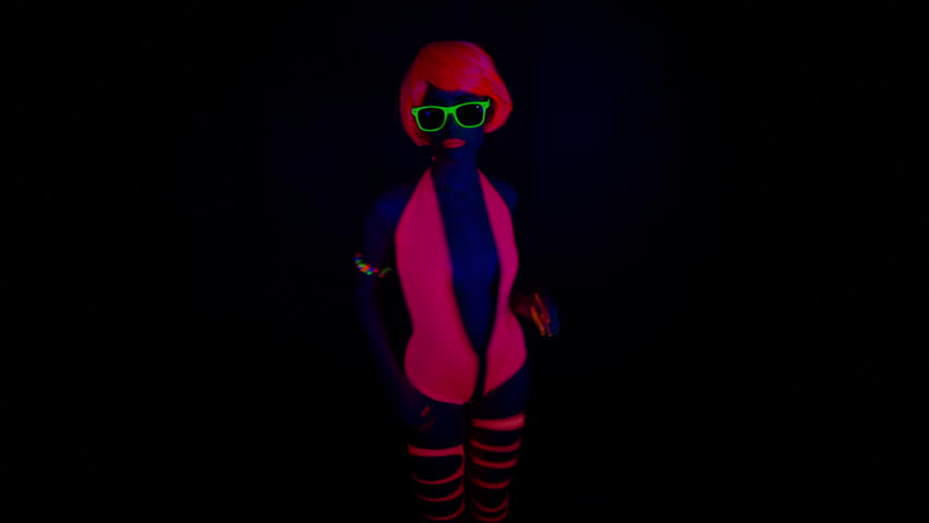 Fantastic video of sexy cyber raver dancer babe filmed in fluorescent clothing under UV black light  | Shutterstock HD Video #8331157