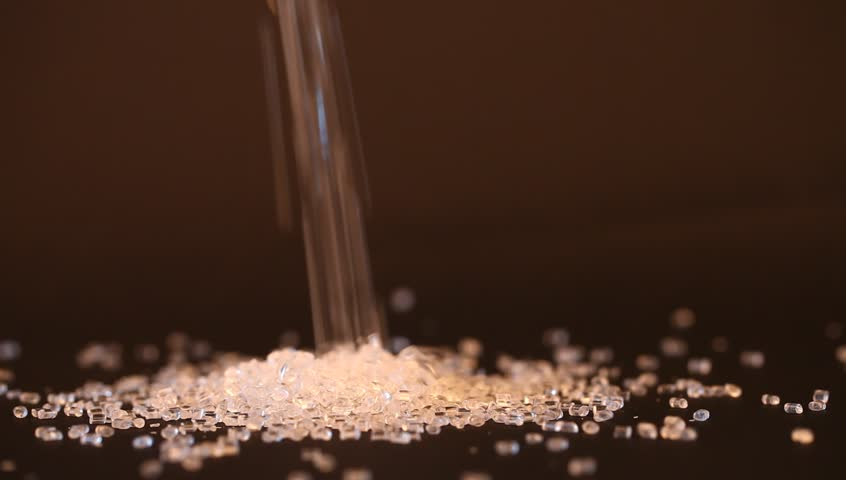 transparent plastic granules closeup for molding
