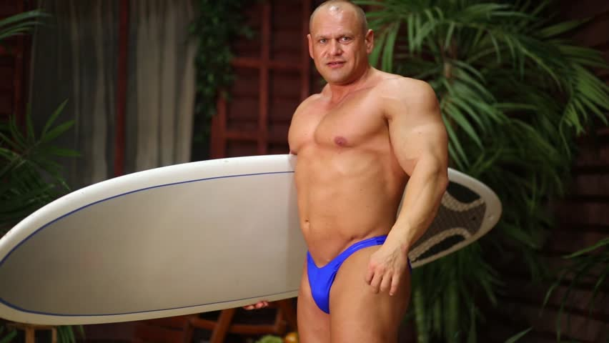 muscular man is punishing tanned lady wearing colorful bikini  346351